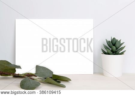Blank Paper Sheet Copy Space With Mockup And Plants In Potted On Wooden Table, Poster And Invitation