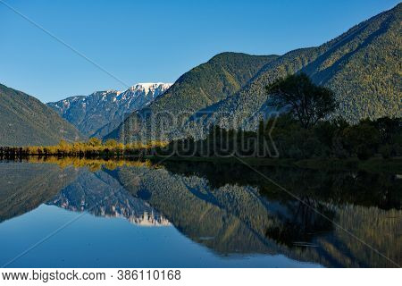 Russia. South Of Western Siberia. Mountain Altai. Cloudless Order On The Southern Coast Of Lake Tele