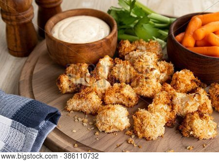 Crispy Air Fried Cauliflower Florets And Ranch Dip With Carrots And Celery On A Wooden Tray