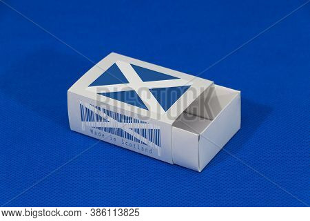 Scotland Flag On White Box With Barcode And The Color Of Nation Flag On Blue Background, Paper Packa