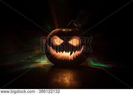 Halloween Pumpkin Smile And Scary Eyes For Party Night. Close Up View Of Scary Halloween Pumpkin Wit