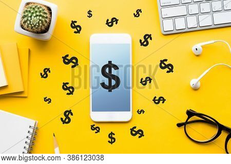 Top View Of Dollar Icon On Mock Up Smartphone And Modern Accessories,supplies On Table Background.bu