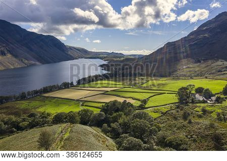 Stunning High Point Of View From Flying Drone Over Lake District Landscape In Late Summer, In Wast W