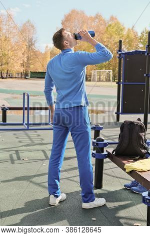 Toned Slim Man Of Middle Age Drinking Whey Protein Cocktail From A Sport Shaker. Using Protein Drink