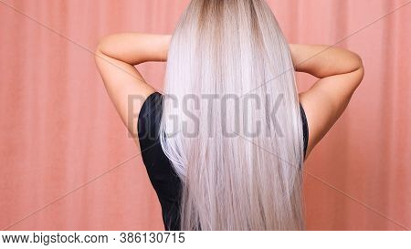 Beautiful Female Luxurious Long Straight Blond Hair. Dyed Wavy White Blond Hair Background, Dyeing,