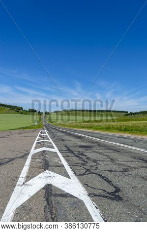 Picturesque Empty Road Along Forest Hills And Green Steppe In Khakassia, East Siberia, Russia.