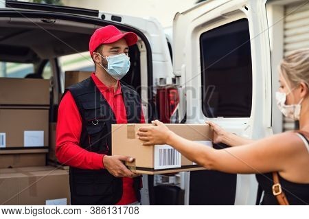 Delivery Man Wearing Face Protective Mask To Avoid Corona Virus Spread - Young Express Courier Deliv