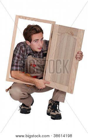 Carpenter with cabinet door
