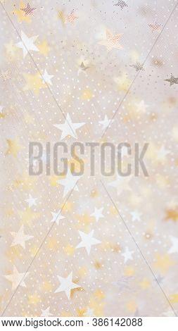 Gold Glitter And Glittering Stars On White Festive Background. Winter Holidays Background. Christmas