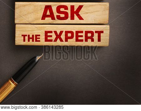 Ask The Expert Words On Wooden Blocks. Consulting A Professional, Master Or Consultant For A Solutio