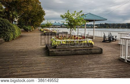 Quay In Pier Park At The Riverfront Of Fraser River In New Westminster City. Wood-covered Promenade