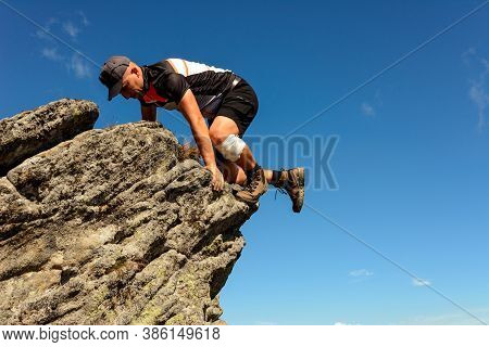 Mountaineering In The Carpathians, A Man Climbs A Rocky Peak Without Protection, Alone, Amateur Moun