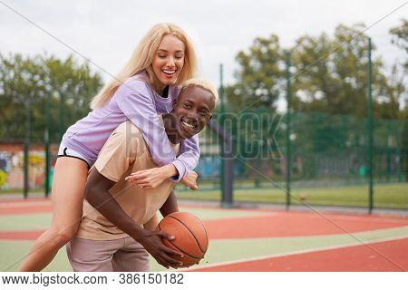 Basketball Piggy Back Ride Afro American Man Friends Training Caucasian Woman Multiracial Friendship