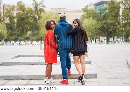 Multi Ethnic Friends Outdoor. Two Woman In Love With One Guy Diverse Group People Afro American Asia