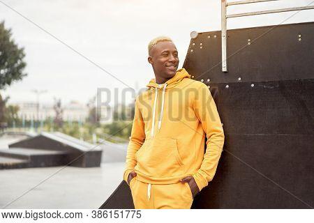 African-american Smiling Black Man Yellow Hoodie Outside Happy Emotional Afro Model Guy Walking Skat