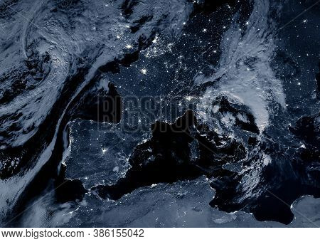 Europe At Night, View Of City Lights Showing Human Activity On Continent From Space. Earth Surface A