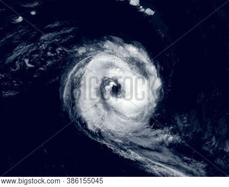 Hurricane Eye Over Sea, View Of Tropical Storm Or Cyclone From Space. Ocean Typhoon On Satellite Pho