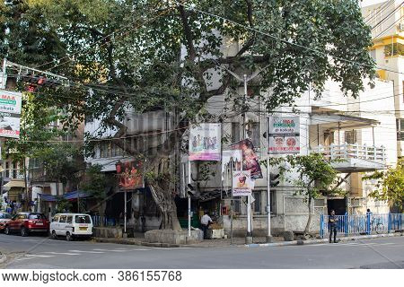 Kolkata, India - February 1, 2020: A Local Street Corner With Parked Cars And Three Unidentified Men