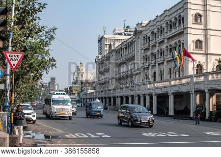 Kolkata, India - February 1, 2020: Everyday Traffic By A Crossroad And Stop Sign With Unidentified P