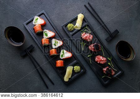 Seafood Delicatessen Sushi Rolls On Plates. Different Gourmet Snacks. Luxury Lifestyle, Japanese Foo