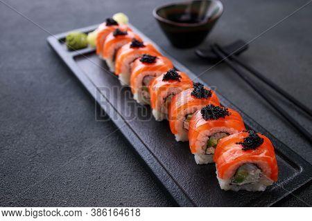 Seafood Delicatessen Salmon Sushi Rolls On Plate. Gourmet Snacks. Luxury Lifestyle, Japanese Food Ar