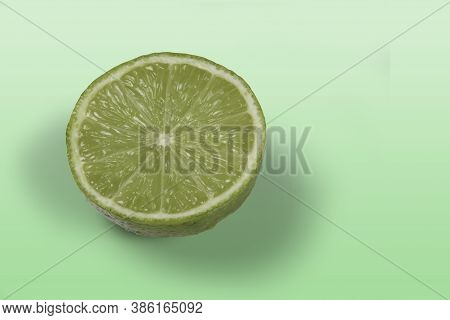 Tahiti Lemon Cut In Half On Light Green Background