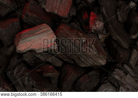Smoldering Charcoal Background. Close-up Of Actively Smoldering Embers With Ash.