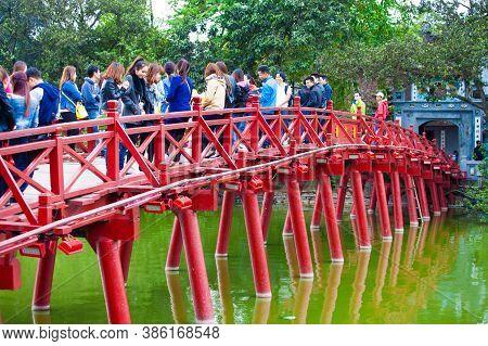 Hanoi, Vietnam - October 21, 2019 : Hanoi red bridge. The wooden red painted bridge over the Hoan Ki