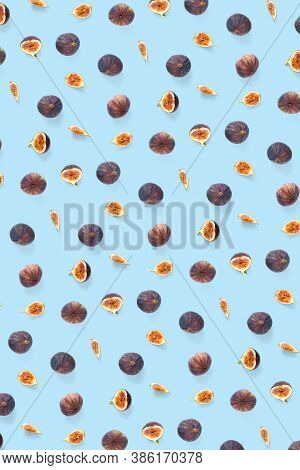 Background From Fresh Figs. Food Photo. Creative Set Of The Whole And Sliced Figs On A Blue Backgrou