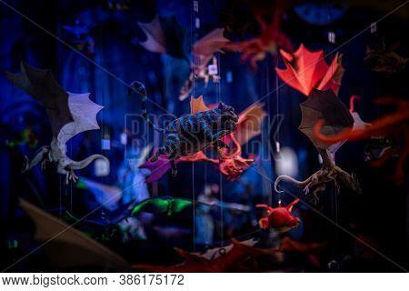 Cheshire Cat And Other Colorful Hanging Toys. Flying Characters From Fantasy Movies Of Magic On A Sh