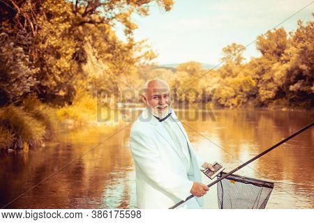 Fisherman In Formal Suit. Real Happiness. Fishing Background. Retirement Fishery. Perfect Weekend. C