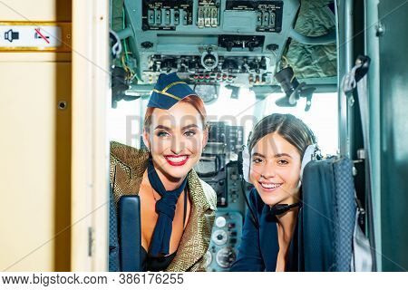 Beautiful Woman Pilot Wearing Uniform. Happy And Successful Flight. Looking At Camera In Plane. Girl
