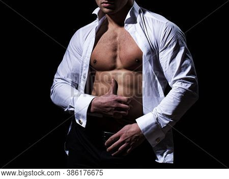 Muscular Man Showing His Chest During Striptease. Mans Torso. Handsome Guy Posing. Fashion Portrait