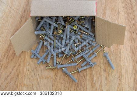 An Overturned Screw Box On Wooden Background