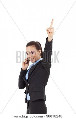 young business woman speaking on mobile phone and finger pointing up to empty copy space, isolated on white background