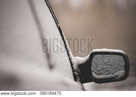 The First Unexpected Snowfall Covered Cars With Snow. Rearview Mirror In The Snow. Traffic Safety. T