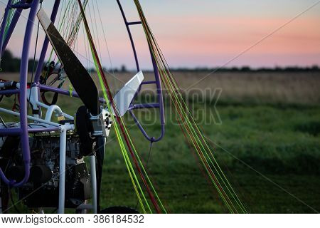 Closeup Of A Motorized Paragliding Trolley With A No-spin Engine, Propeller And Colorful Lines On Th
