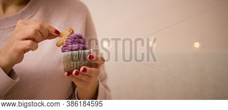 The Hands Of A Young Girl Hold A Delicious Sweet Christmas Cake Decorated With A Gingerbread Man On