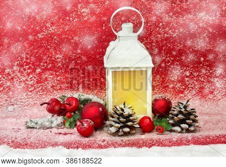 Christmas Decoration. Christmas Lantern, Red Balls, Cones, Red Apples, Twigs Christmas Tree On Red G