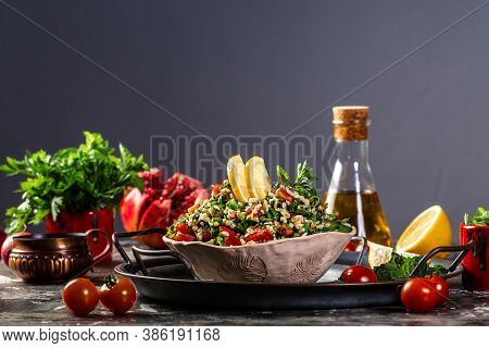 Arabic Salad Tabbouleh In A Bowl. Middle Eastern Cuisine. Healthy Salad With Bulgur, Parsley And Veg