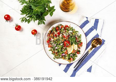 Traditional Arabic Salad Tabbouleh Middle Eastern Or Arab Dish. Levantine Vegetarian Salad With Pars