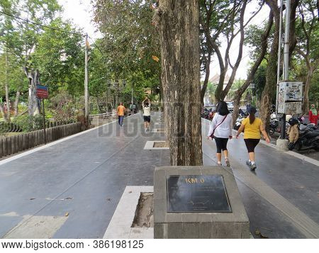 Denpasar, Indonesia - September 28, 2019: Some People Having Activities On The Sidewalk Around Titik