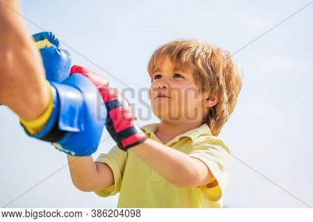 Father Is Training His Son Boxing. Little Boy Doing Boxings Exercise With Grandfather. Little Boy Sp