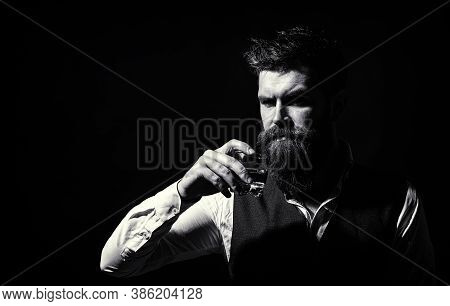 Bearded Drink Cognac. Sommelier Tastes Drink. Man Holding A Glass Of Whisky. Closeup Portrait. Sippi