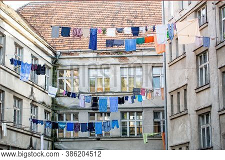 Washed Clothes Drying Outside Of An Old House. Washed Clothes Drying. Fresh Clean Clothes Are Drying