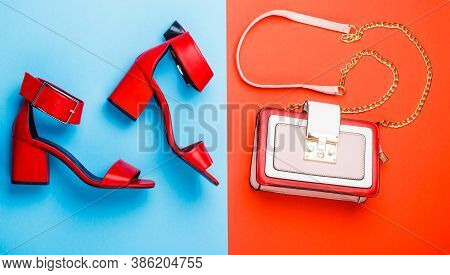 Woman Bag, Sandals On Red And Blue Background Isolation. Ladies Bag And Stylish Red Shoes. Stylish R
