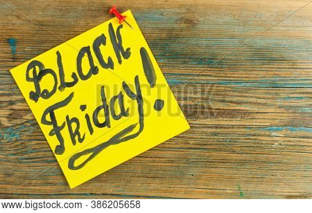 Black Friday handwriting text close up on sticky notes with copy space. Writing text on memo post reminder