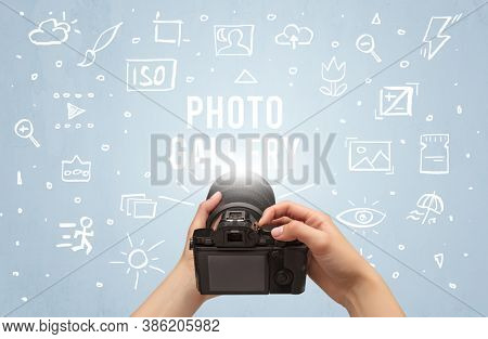 Hand taking picture with digital camera and PHOTO GALLERY inscription, camera settings concept