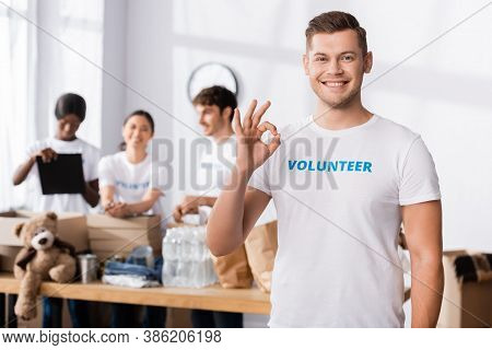 Selective Focus Of Volunteer Showing Okay Gesture At Camera In Charity Center