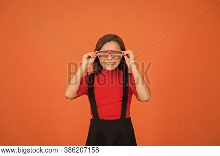 Perfect For School Party. Happy Party Girl Orange Background. Little Kid Wear Party Glasses. Small C